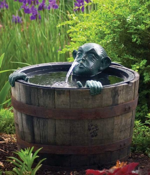 Man in barrel pond and barrel spitter by aquascape for Fish pond materials