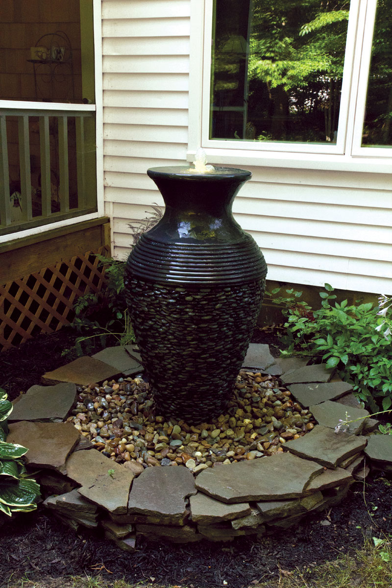 Round disappearing water feature fountain basin by for Ornamental garden features